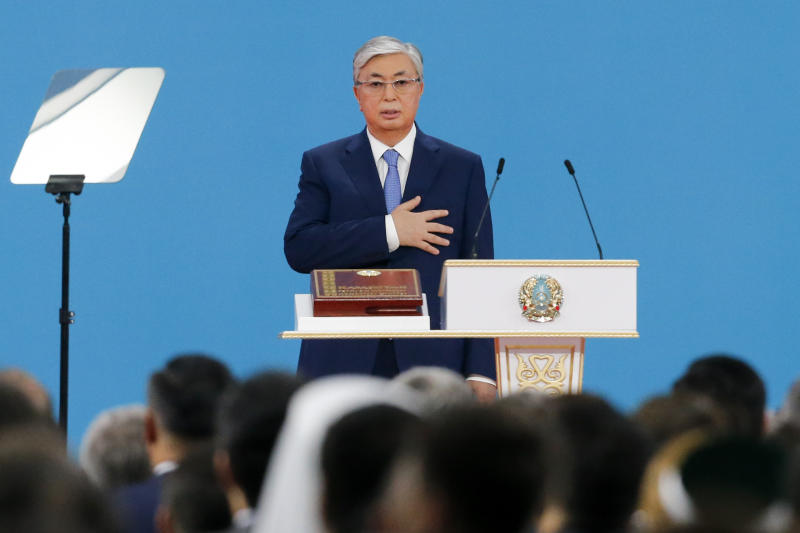 Kazakhstan's President-elect Kassym-Jomart Tokayev puts his hand on heart as he takes the oath of office during his inauguration ceremony in Nur-Sultan, the capital city of Kazakhstan, Wednesday, June 12, 2019. Tokayev, an ally of Kazakhstan's former president was named the winner of the presidential election on Monday in a vote marred by a police crackdown on protesters who criticized the result as an orchestrated handover of power. (AP Photo/Alexei Filippov)