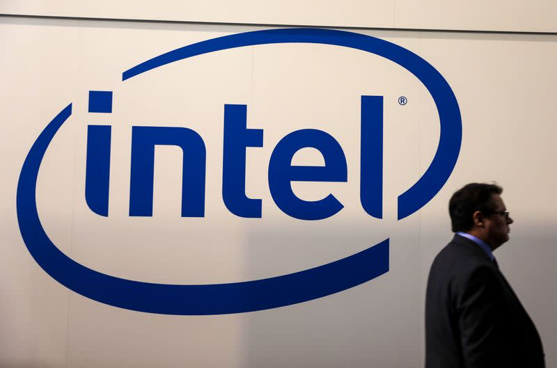 A visitor passes an Intel logo at the Mobile World Congress in Barcelona