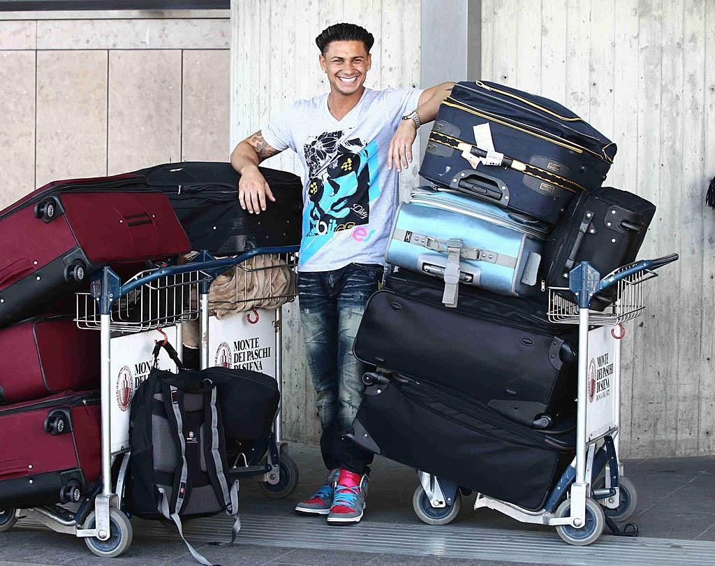 "A very happy Pauly D was snapped at the airport in Florence, Italy -- where his reality show ""Jersey Shore"" will be shooting this season -- with enough luggage for a lifelong stay. But how many of those suitcases are filled with hair gel? Ditoj/<a href=""http://www.splashnewsonline.com"" target=""new"">Splash News</a> - May 13, 2011"