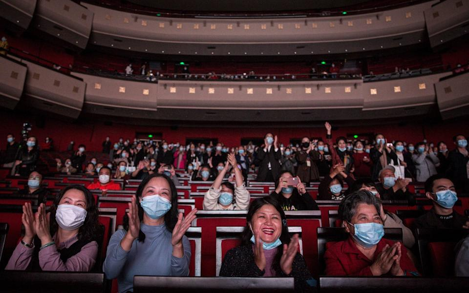 """The audience applauds after the opera """"Angel's Diary"""" which portrays the doctor's rescue of coronavirus patients during the lockdown in Wuhan - Getty"""