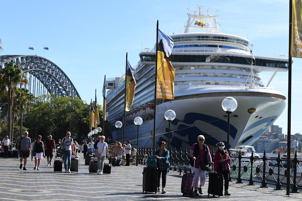 Pictured are Ruby Princess cruise passengers disembarking the ship in Circular Quay, Sydney.