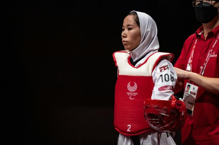 Afghanistan's Zakia Khudadadi competed in the first match of the day after her dramatic evacuation from Kabul (AFP/Philip FONG)
