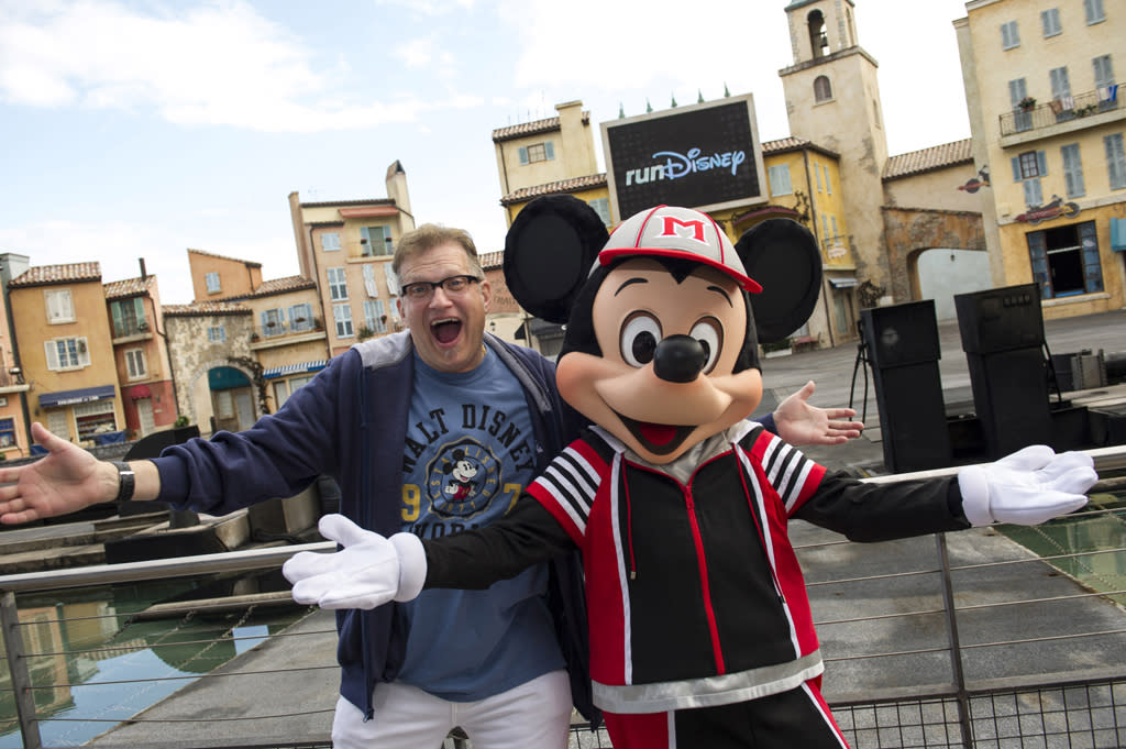 "LAKE BUENA VISTA, FL - JANUARY 11:  In this handout image provided by Disney Parks, actor Drew Carey, host of ""The Price is Right,"" poses with Mickey Mouse at a kickoff celebration for the ""2013 Walt Disney World Marathon Weekend at Disney's Hollywood Studios January 11, 2013 in Lake Buena Vista, Florida.  Carey is one of the special guests attending the annual weekend of endurance races and health and fitness seminars at Walt Disney World.  (Photo by Ali Nasser/Disney Parks via Getty Images)"