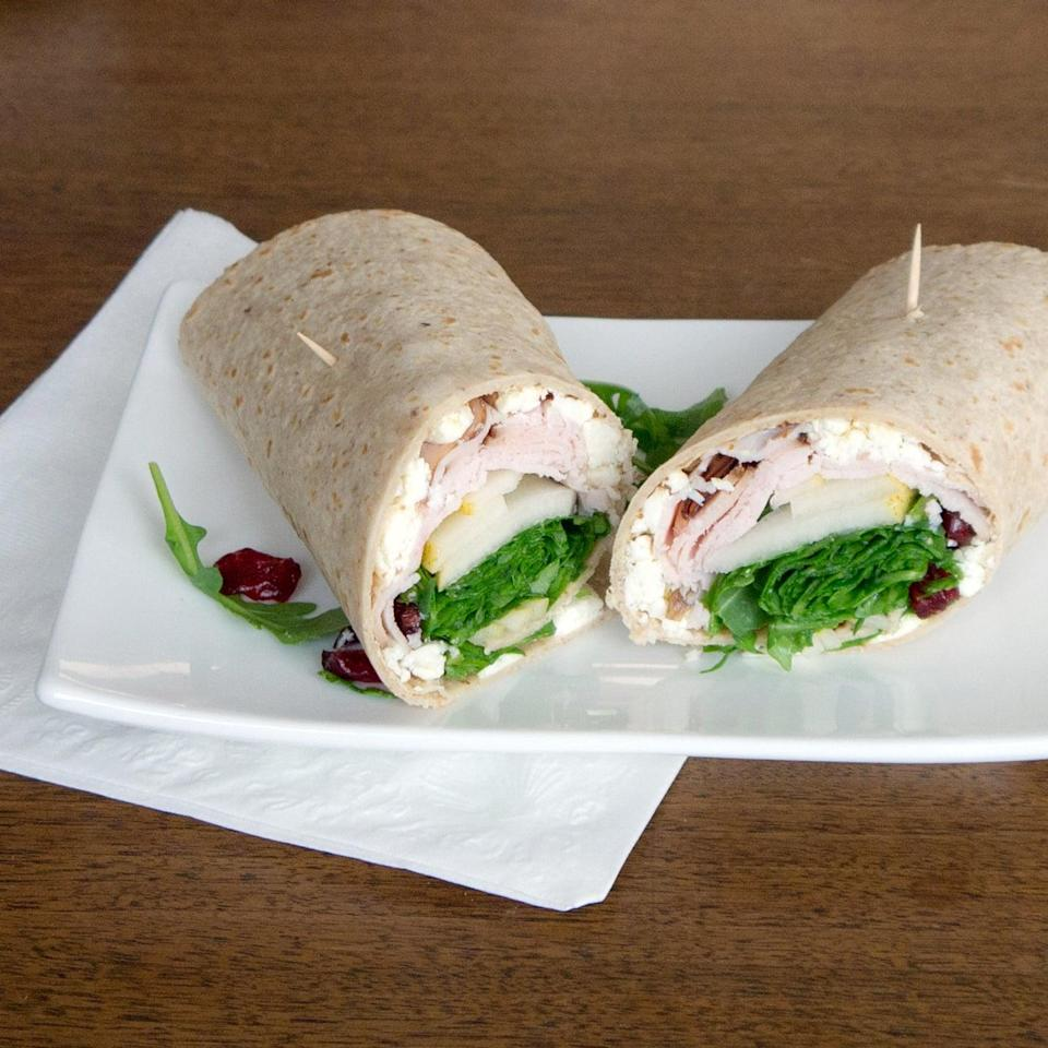 <p>Bread can be tricky to keep fresh, so try a turkey wrap in a wheat tortilla instead. This one is packed with feta cheese, pear, and dried cranberries.</p>