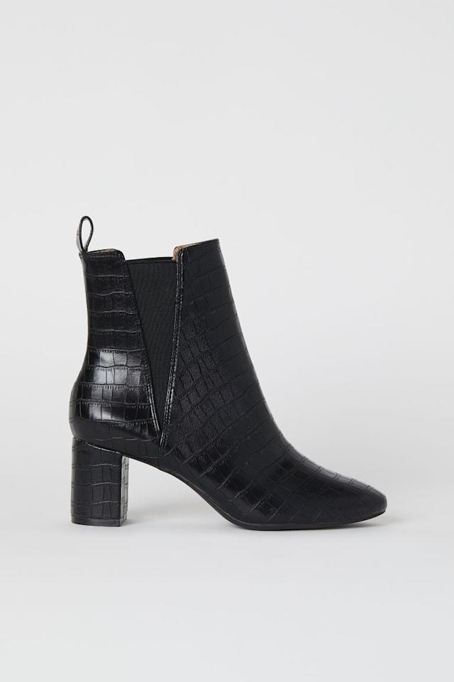 "<p>Elevate any look with these <a href=""https://www.popsugar.com/buy/HampM-Ankle-Boots-Side-Panels-485159?p_name=H%26amp%3BM%20Ankle%20Boots%20With%20Side%20Panels&retailer=www2.hm.com&pid=485159&price=50&evar1=fab%3Aus&evar9=46556164&evar98=https%3A%2F%2Fwww.popsugar.com%2Ffashion%2Fphoto-gallery%2F46556164%2Fimage%2F46556574%2FHM-Ankle-Boots-With-Side-Panels&list1=shopping%2Cfall%20fashion%2Cshoes%2Cfall%2Cworkwear%2Cunder%20%2450%2Caffordable%20shopping&prop13=mobile&pdata=1"" rel=""nofollow"" data-shoppable-link=""1"" target=""_blank"" class=""ga-track"" data-ga-category=""Related"" data-ga-label=""https://www2.hm.com/en_us/productpage.0783636003.html"" data-ga-action=""In-Line Links"">H&amp;M Ankle Boots With Side Panels</a> ($50).</p>"