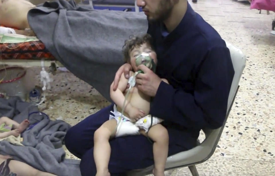 <p>This image made from video released by the Syrian Civil Defense White Helmets, which has been authenticated based on its contents and other AP reporting, shows a medical worker giving toddlers oxygen through respirators following an alleged poison gas attack in the opposition-held town of Douma, in eastern Ghouta, near Damascus, Syria, Sunday, April 8, 2018. (Photo: Syrian Civil Defense White Helmets via AP) </p>