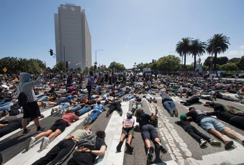 Protesters and supporters of Black Lives Matter lie in the street in Westwood, California. Source: Getty Images