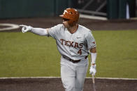 Texas' Silas Ardoin (4) reacts to his dugout after he was walked to load the bases during the fifth inning of an NCAA Super Regional college baseball game against South Florida, Sunday, June 13, 2021, in Austin, Texas. (AP Photo/Eric Gay)