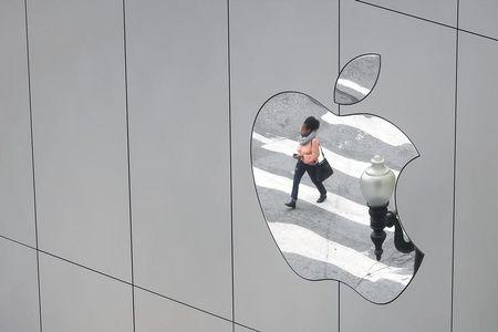 FILE PHOTO - A woman is reflected in a Apple store logo in San Francisco, California, U.S., August 21, 2017.   REUTERS/Kevin Coombs