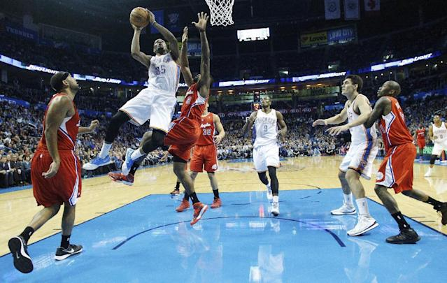 Oklahoma City Thunder forward Kevin Durant (35) shoots over Los Angeles Clippers center DeAndre Jordan (6) in the first quarter of an NBA basketball game in Oklahoma City, Thursday, Nov. 21, 2013. (AP Photo/Sue Ogrocki)