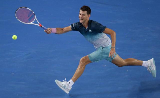 Austria's Dominic Thiem plays a forehand return to France's Benoit Paire during their first round match at the Australian Open tennis championships in Melbourne, Australia, Wednesday, Jan. 16, 2019. (AP Photo/Mark Schiefelbein)