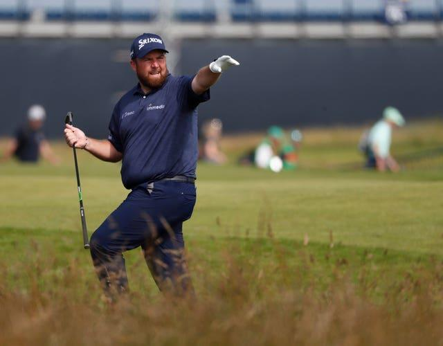Shane Lowry gestures after playing out of the rough