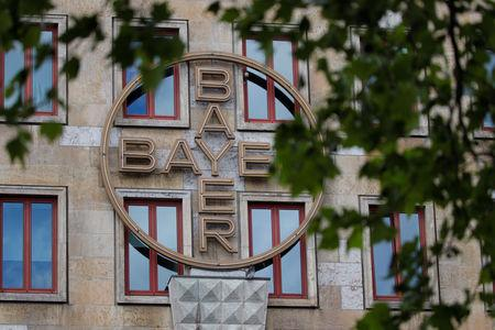 FILE PHOTO: The logo of Bayer AG is pictured at the facade of the historic headquarters of the German pharmaceutical and chemical maker in Leverkusen, Germany, May 14, 2019. REUTERS/Wolfgang Rattay/File Photo