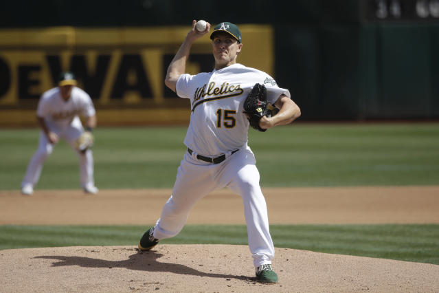 Oakland Athletics pitcher Homer Bailey throws to a Kansas City Royals batter during the first inning of a baseball game in Oakland, Calif., Wednesday, Sept. 18, 2019. (AP Photo/Jeff Chiu)