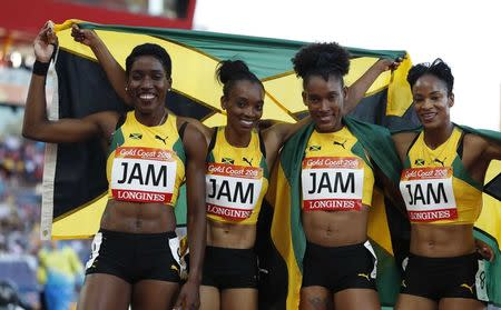 Athletics - Gold Coast 2018 Commonwealth Games - Women's 4x400m - Final - Carrara Stadium - Gold Coast, Australia - April 14, 2018. Christine Day, Anastasia Le-Roy, Janieve Russell and Stephenie McPherson of Jamaica pose after winning the gold medal. REUTERS/Paul Childs