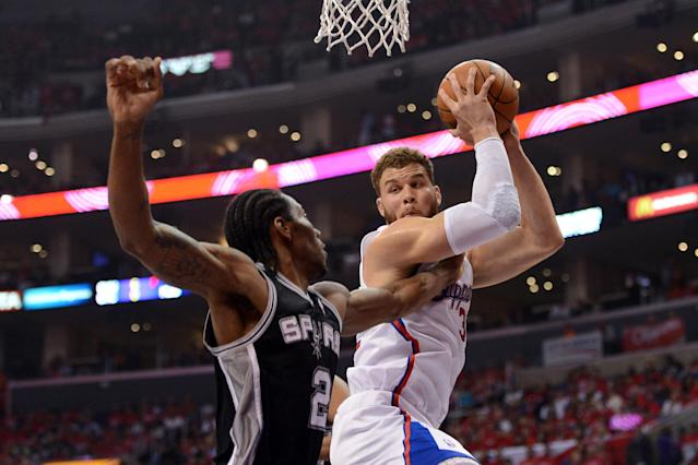 LOS ANGELES, CA - MAY 20: Blake Griffin #32 of the Los Angeles Clippers grabs a rebound against Kawhi Leonard #2 of the San Antonio Spurs in the first quarter in Game Four of the Western Conference Semifinals in the 2012 NBA Playoffs on May 20, 2011 at Staples Center in Los Angeles, California. NOTE TO USER: User expressly acknowledges and agrees that, by downloading and or using this photograph, User is consenting to the terms and conditions of the Getty Images License Agreement. (Photo by Harry How/Getty Images)