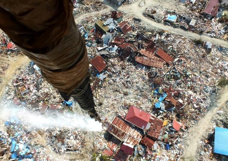 The view of devastation from a helicopter releasing disinfectant over Palu in a bid to stop outbreaks of disease