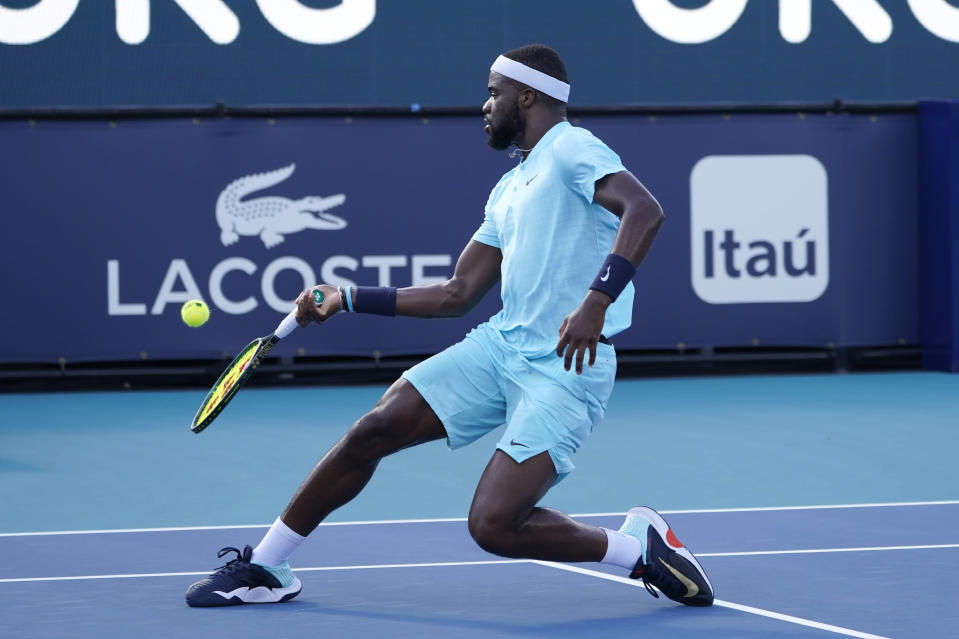Frances Tiafoe returns to Daniil Medvedev of Russia, during the Miami Open tennis tournament, Tuesday, March 30, 2021, in Miami Gardens, Fla. (AP Photo/Marta Lavandier)