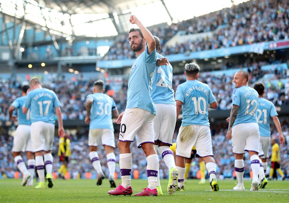 MANCHESTER, ENGLAND - SEPTEMBER 21:  Bernardo Silva of Manchester City celebrates after scoring his team's seventh goal and completes his hat trick with team mates during the Premier League match between Manchester City and Watford FC at Etihad Stadium on September 21, 2019 in Manchester, United Kingdom. (Photo by Matt McNulty - Manchester City/Manchester City FC via Getty Images)