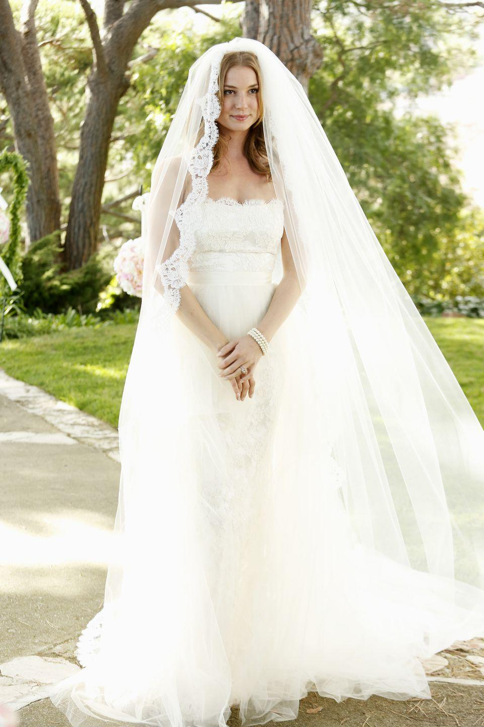 """<p>Emily's plan was almost complete with her impending vows to Daniel Grayson...she just had to say """"I do."""" For her big day, she wore a strapless lace gown with a tulle tearaway skirt that was <a href=""""https://www.eonline.com/news/475777/revenge-wedding-first-look-costume-designer-sounds-off-on-creating-emily-s-gorgeous-gown-see-the-pic"""" rel=""""nofollow noopener"""" target=""""_blank"""" data-ylk=""""slk:designed by the show's costume designer"""" class=""""link rapid-noclick-resp"""">designed by the show's costume designer</a>, Jill Ohannesson. </p>"""