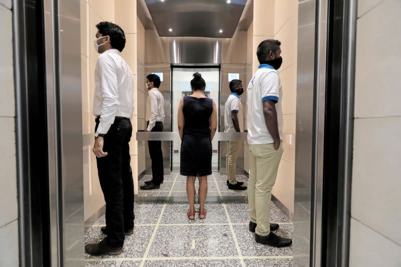 FILE PHOTO: People practice social distancing inside an elevator at World Trade Center in Colombo, Sri Lanka
