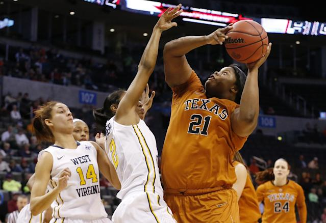 Texas forward Nekia Jones (21) shoots in front of West Virginia forward Jess Harlee (14) and guard Taylor Palmer (2) in the second half of an NCAA college basketball game in the semifinals of the Big 12 Conference women's tournament in Oklahoma City, Sunday, March 9, 2014. West Virginia won 67-60. (AP Photo/Sue Ogrocki)