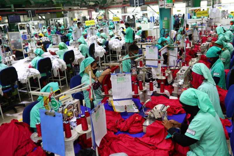 Garment employees work in a sewing section of the Fakhruddin Textile Mills Limited in Gazipur