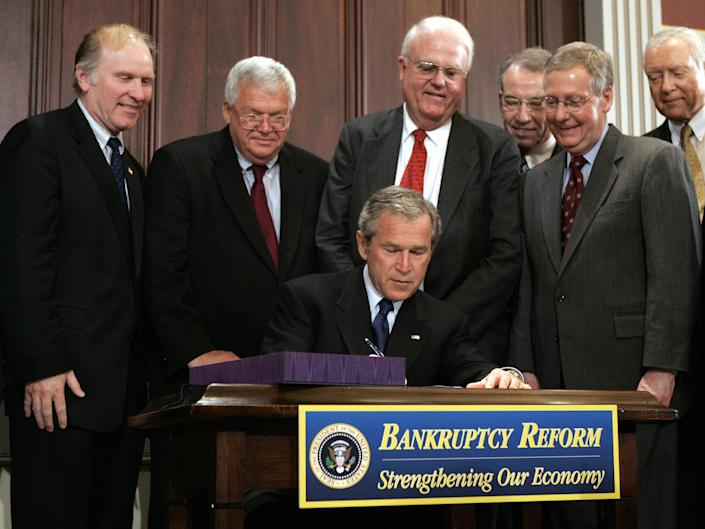 President George W. Bush signs the Bankruptcy Abuse Prevention and Consumer Protection Act of 2005 in 2005 (BRENDAN SMIALOWSKI/AFP via Getty Images)