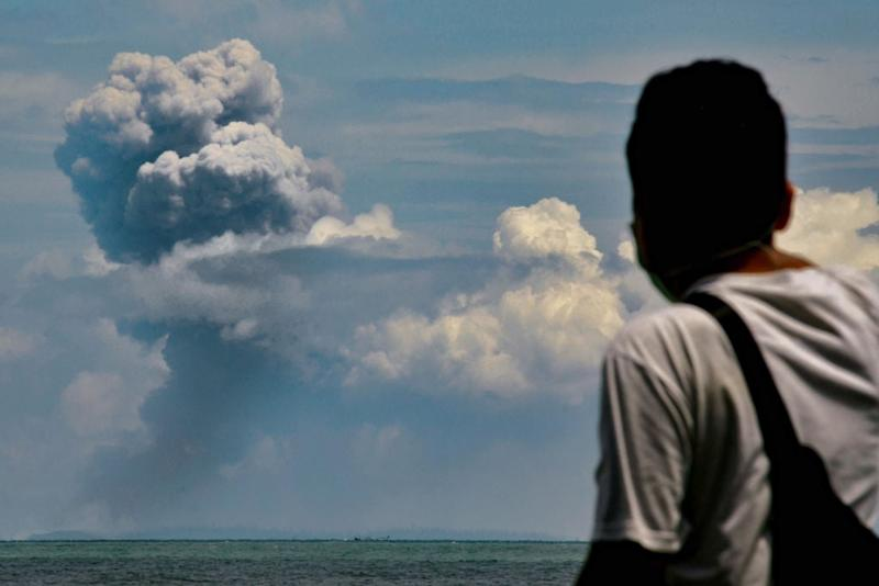 Man watches Krakatau spewing ash during an eruption on Saturday: Getty
