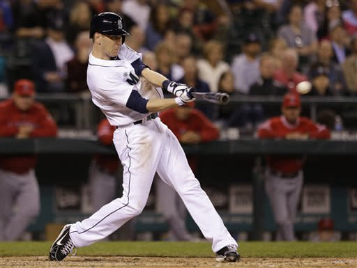 Seattle Mariners' Jason Bay singles in a pair of runs against the Los Angeles Angels in the seventh inning of a baseball game Thursday, April 25, 2013, in Seattle. (AP Photo/Elaine Thompson)