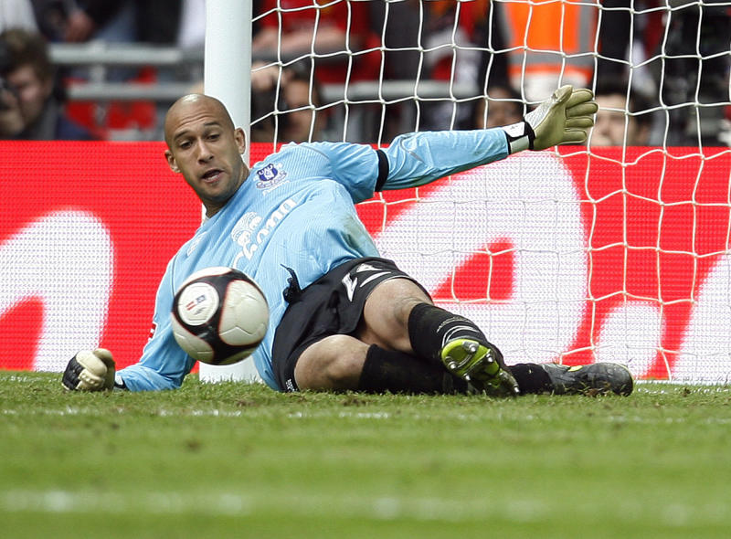 FILE - In this April 19, 2009 file photo, Everton's Tim Howard saves a shot from Manchester United's Dimitar Berbatov during the penalty shoot out for their FA Cup semi-final soccer match at Wembley Stadium, London. United States goalkeeper Tim Howard has extended his contract at Everton Thursday March 8, 2012, tying him to the Premier League club until 2016. If the 33-year-old Howard stays at the northwest club until the end of his new deal, he will have spent 10 years at Goodison Park after having initially signed on loan for Everton from Manchester United in 2006. (AP Photo/Paul Thomas, File)