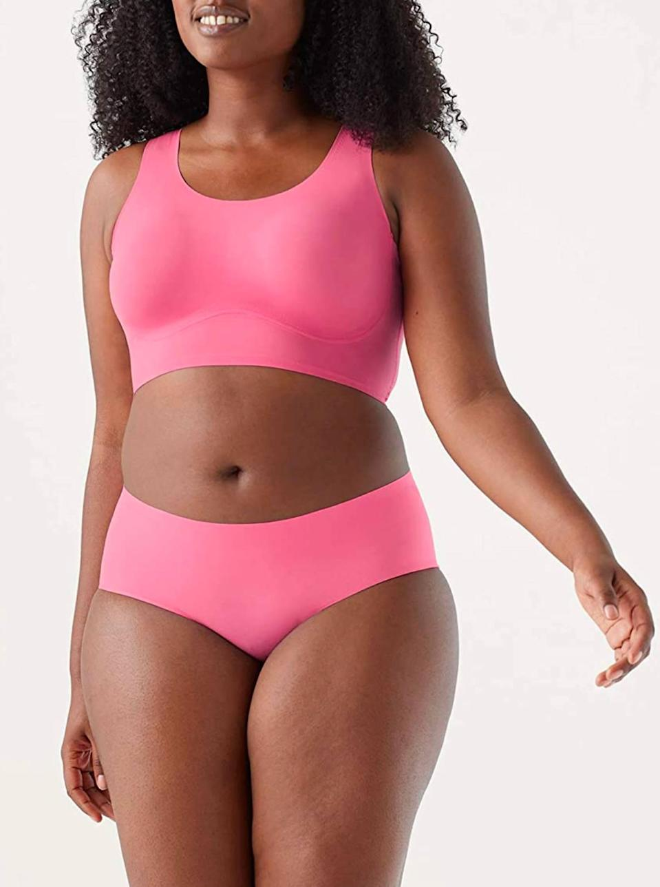 """True & Co makes some of the best <a href=""""https://www.glamour.com/gallery/best-wireless-bras?mbid=synd_yahoo_rss"""" rel=""""nofollow noopener"""" target=""""_blank"""" data-ylk=""""slk:seamless bras"""" class=""""link rapid-noclick-resp"""">seamless bras</a> in the game, so it should come as no surprise that its underwear is just as good. Our top pick? These hot pink boyshorts, because let's be real—when you're wearing <a href=""""https://www.glamour.com/gallery/best-black-leggings-to-buy-now?mbid=synd_yahoo_rss"""" rel=""""nofollow noopener"""" target=""""_blank"""" data-ylk=""""slk:black leggings"""" class=""""link rapid-noclick-resp"""">black leggings</a> or <a href=""""https://www.glamour.com/story/best-bike-shorts?mbid=synd_yahoo_rss"""" rel=""""nofollow noopener"""" target=""""_blank"""" data-ylk=""""slk:bike shorts"""" class=""""link rapid-noclick-resp"""">bike shorts</a>, it doesn't really matter what color panties you have on. $16, Amazon. <a href=""""https://www.amazon.com/True-Co-Boyshort-Multipack-Chateau/dp/B08Q3XWNLZ/ref="""" rel=""""nofollow noopener"""" target=""""_blank"""" data-ylk=""""slk:Get it now!"""" class=""""link rapid-noclick-resp"""">Get it now!</a>"""