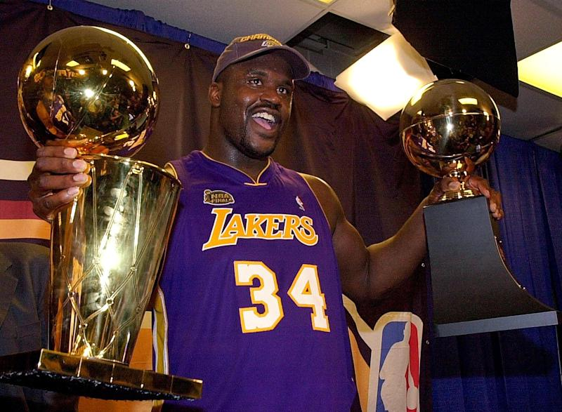 Shaquille O'Neal after winning his second NBA championship and Finals MVP in 2001. (Stan Honda/AFP via Getty Images)