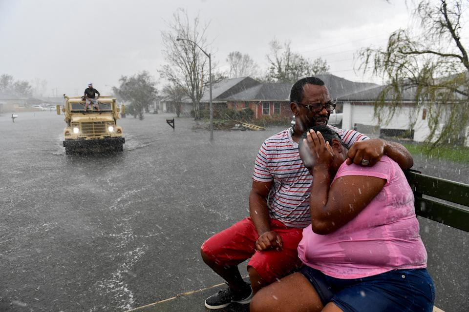 Just as more showers start, a high-water truck arrives to assist people evacuating from flooded homes in LaPlace, La., on Aug. 30, 2021.