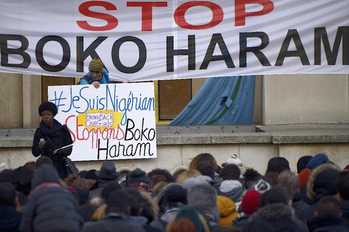 "Demonstrators holds placards and banners reading ""I am Nigerian"" and ""Stop Boko Haram"" during a gathering in Paris on January 18, 2015 (AFP Photo/Lionel Bonaventure)"