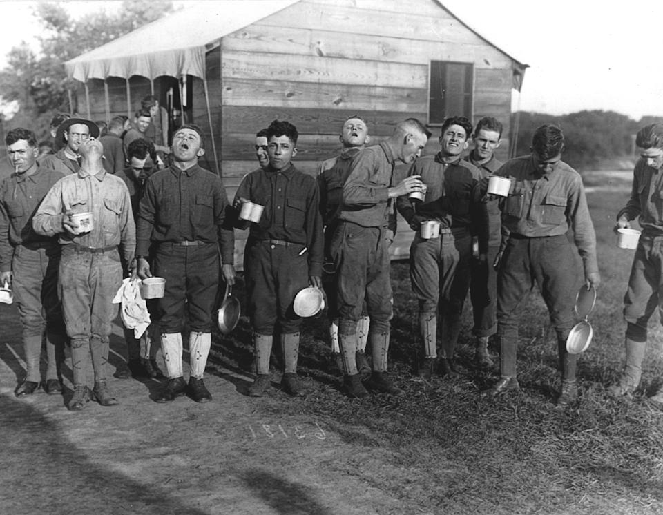 Men gargle with salt and water as a preventive measure against the influenza epidemic at Camp Dix, New Jersey, in September 1918. (Photo: Photo by PhotoQuest/Getty Images)