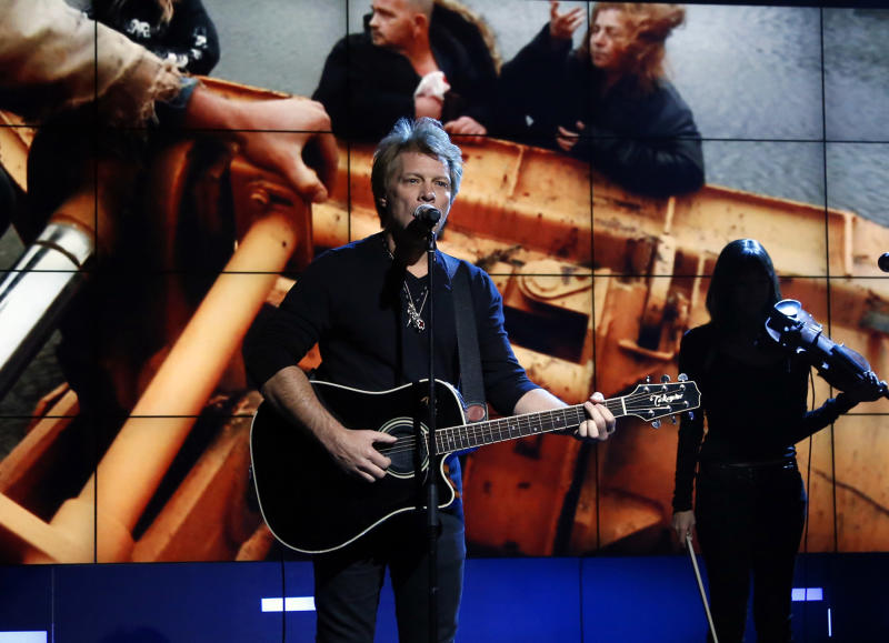 "In this photo provided by NBC, Jon Bon Jovi performs during ""Hurricane Sandy: Coming Together"" Friday, Nov. 2, 2012, in New York. Hosted by Matt Lauer, the event is heavy on stars identified with New Jersey and the New York metropolitan area, which took the brunt of this week's deadly storm. (AP Photo/NBC, Heidi Gutman)"