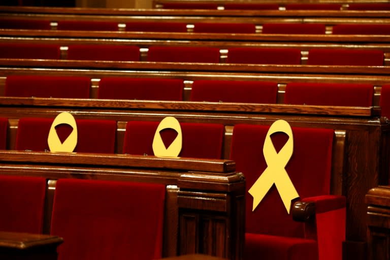 Yellow ribbons in support of jailed Catalan separatist leaders are displayed on seats at the Catalan parliament