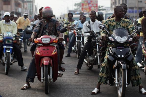 COTONOU, BENIN - JANUARY 06:  Traffic builds up at rush hour on January 6, 2012 in Cotonou, Benin. Much of Cotonou's hectic traffic comprises of motorcycles and scooters. The primary fuel known as 'Kpayo', imported from Nigeria, has a hold over almost 90 percent of the fuel market in Benin where removal of subsidy on fuel by the Nigerian Government has been reflected in higher prices.  (Photo by Dan Kitwood/Getty Images)