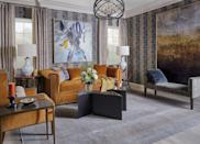 """<p>Create a cozy and inviting space by mixing in hues found in nature. Keita Turner of <a href=""""https://www.keitaturnerdesign.com/"""" rel=""""nofollow noopener"""" target=""""_blank"""" data-ylk=""""slk:Keita Turner Design"""" class=""""link rapid-noclick-resp"""">Keita Turner Design</a> added dimension to this living room by layering rich rust furniture and gold art and accessories. </p>"""