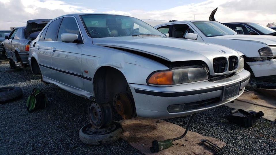 """<p>I've documented <a href=""""http://www.murileemartin.com/Junkyard/JunkyardGallery-BMW.html"""" rel=""""nofollow noopener"""" target=""""_blank"""" data-ylk=""""slk:plenty of discarded BMWs"""" class=""""link rapid-noclick-resp"""">plenty of discarded BMWs</a> during <a href=""""http://www.murileemartin.com/JunkyardGalleryHome.html"""" rel=""""nofollow noopener"""" target=""""_blank"""" data-ylk=""""slk:my searching of car graveyards"""" class=""""link rapid-noclick-resp"""">my searching of car graveyards</a> for interesting bits of <a class=""""link rapid-noclick-resp"""" href=""""https://www.autoblog.com/category/automotive-history/"""" data-ylk=""""slk:automotive history"""">automotive history</a>, but I've been remiss in documenting examples of the <a href=""""https://www.autoblog.com/bmw/5+series/"""" data-ylk=""""slk:BMW 5 Series"""" class=""""link rapid-noclick-resp"""">BMW 5 Series</a>. I've shot <a href=""""https://www.autoblog.com/2018/07/26/junkyard-gem-1980-bmw-528i/"""" data-ylk=""""slk:E12s"""" class=""""link rapid-noclick-resp"""">E12s</a> and <a href=""""https://autoweek.com/article/junkyard-treasures/junkyard-treasure-1993-bmw-525i-touring"""" rel=""""nofollow noopener"""" target=""""_blank"""" data-ylk=""""slk:E34s"""" class=""""link rapid-noclick-resp"""">E34s</a>, but missed the immediate successor of the E12 (<a href=""""https://en.wikipedia.org/wiki/BMW_5_Series_(E28)"""" rel=""""nofollow noopener"""" target=""""_blank"""" data-ylk=""""slk:the E28"""" class=""""link rapid-noclick-resp"""">the E28</a>) and the 5 Series that followed the E34 (<a href=""""https://en.wikipedia.org/wiki/BMW_5_Series_(E39)"""" rel=""""nofollow noopener"""" target=""""_blank"""" data-ylk=""""slk:the E39"""" class=""""link rapid-noclick-resp"""">the E39</a>). E28s and E39s aren't too difficult to find in the big California self-service yards, so I vowed that I'd shoot the next example of each that I saw when I took a trip to the Golden State last week. Here's a still-shiny E39 that I found in a yard on California's Central Coast. <a href=""""https://www.autoblog.com/2019/12/10/junkyard-gem-1998-bmw-528i/"""" data-ylk=""""slk:Read more"""" class=""""link rapid-noclick-resp""""><em>Read"""