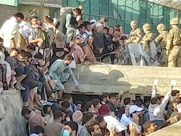 Security personnel assist with evacuation of the people waiting outside the airport in Kabul, Afghanistan August 25, 2021 in this picture obtained from social media. Twitter/DAVID_MARTINON via REUTERS (Photo: TWITTER via via REUTERS)