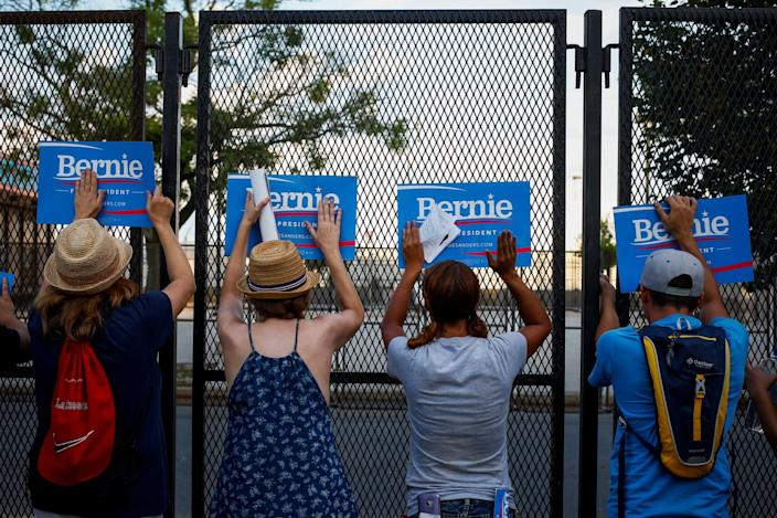 Supporters of Sen. Bernie Sanders make a last-ditch effort to appeal to delegates as they enter Wells Fargo Center on day two of the Democratic National Convention in Philadelphia. (Photo: Adrees Latif/Reuters)