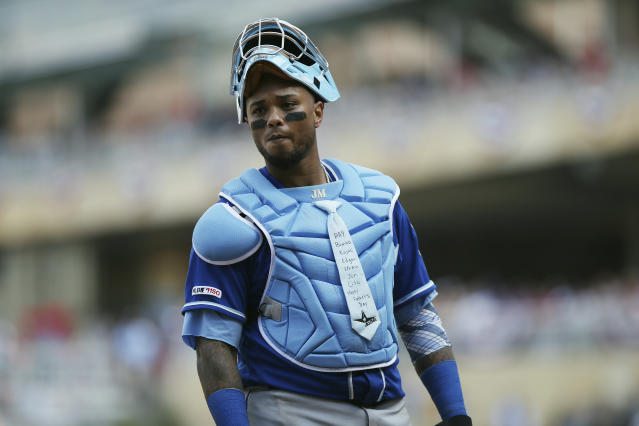 Kansas City Royals' Martin Maldonado looks on during a baseball game against the Minnesota Twins, Sunday, June 16, 2019, in Minneapolis. Maldonado celebrated Father's Day by wearing a blue necktie on his chest protector and had three hits to lift the Kansas City Royals over the Minnesota Twins 8-6 on Sunday. (AP Photo/Stacy Bengs)