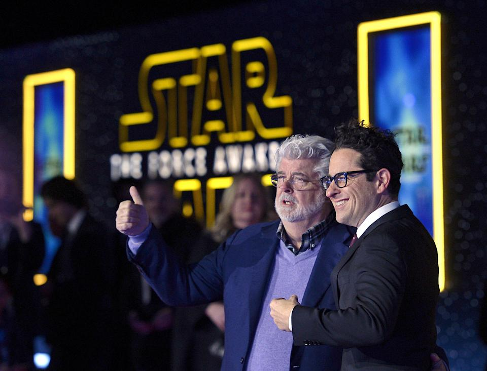 "Star Wars creator George Lucas (L) and director JJ Abrahms pose at the premiere of ""Star Wars: The Force Awakens"" in Hollywood, California December 14, 2015. REUTERS/Kevork Djansezian      TPX IMAGES OF THE DAY"