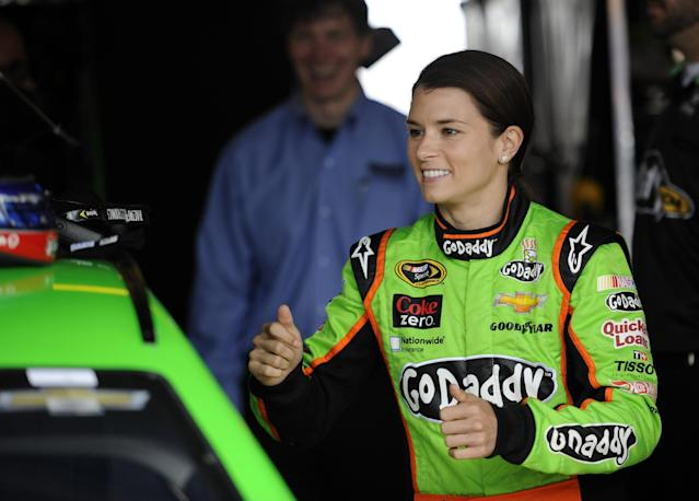 Danica Patrick smiles in the garage area before practice for Sunday's NASCAR Sprint Cup series auto race, Friday, Sept. 27, 2013, at Dover International Speedway in Dover, Del. (AP Photo/Nick Wass)