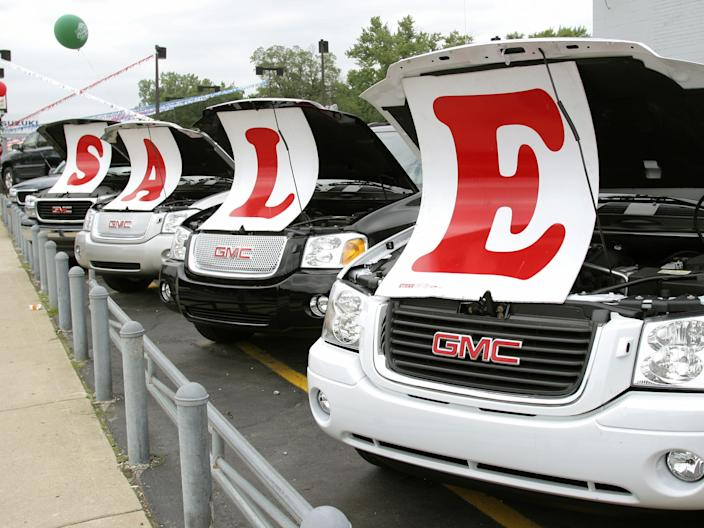 Sale signs lie on vehicles at a General Motors Chevrolet dealership July 6, 2005 in Ferndale, Michigan