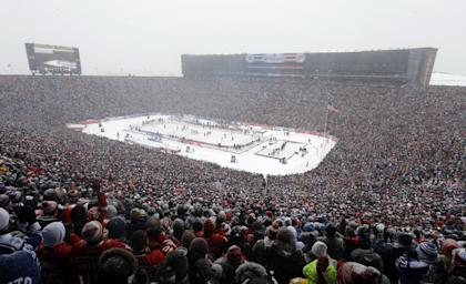 More than 100,000 fans packed Michigan Stadium for the 2014 Winter Classic. (AP Photo/Carlos Osorio)
