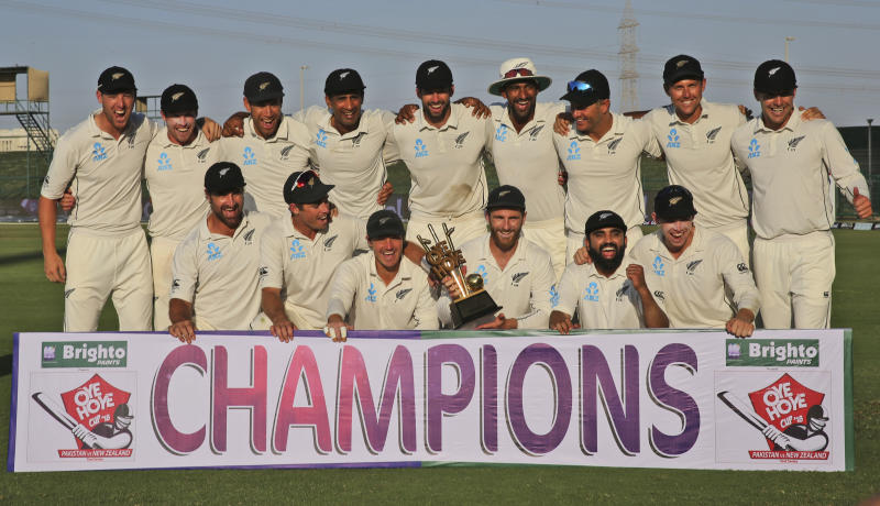 New Zealand's player celebrate with trophy after they beat Pakistan in test series in Abu Dhabi, United Arab Emirates, Friday, Dec. 7, 2018. (AP Photo/Kamran Jebreili)