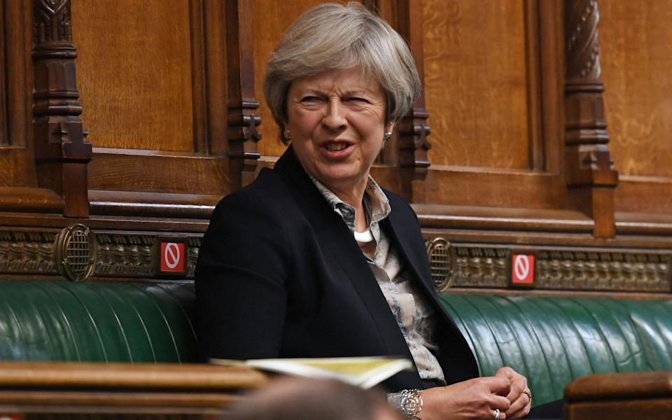 Theresa May introduced the salary rule in 2011 - Jessica Taylor/AFP